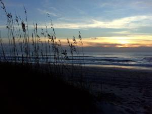 The sunrises over Carolina Beach on Oct. 1, 2010, a day after a massive rainstorm flooded downtown.