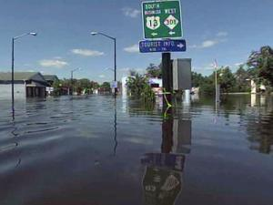 The flood waters in Windsor dropped about 2.5 feet between sunrise and lunchtime Saturday.