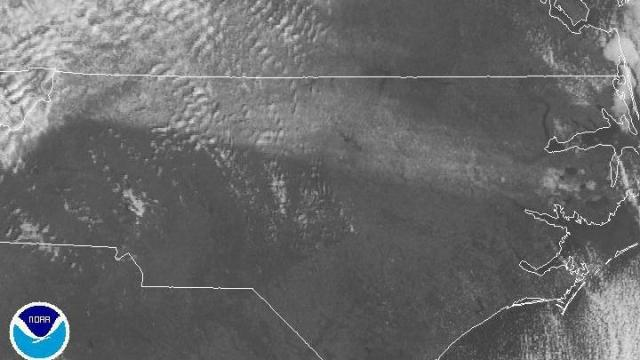 Visible satellite image from NOAA showing snow on the ground from northwestern NC into the north central Coastal Plain. Image from mid-morning on Sunday, Dec 5, 2010. There are some banded clouds above the snow over western Virginia and the northern Piedmont of our state, and some low clouds above the snow just north of the Pamlico River.