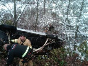 A Blowing Rock man's SUV rolled off the road and dangled, suspended only by branches.