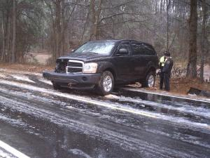A North Carolina State Highway Patrol vehicle slid on ice in Raleigh Thursday. The wreck injured two civilian employees.
