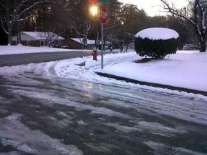 A combination of snow, ice and slush remained in the intersection of Sierra Drive and Saturn Street in southwest Raleigh on Dec. 27, 2010, a day after a storm dumped several inches of snow on the Triangle.