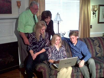 Jonathan, Suzanne, and Leslie Taylor look at photos from their Japan trip with their parents at their Lillington home on March 14, 2011.