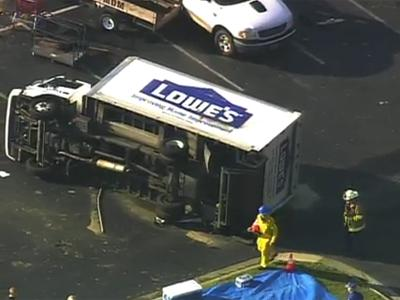 A Lowe's Home Improvement truck flipped over Saturday, April 16, 2011, in Sanford after a tornado demolished the store.