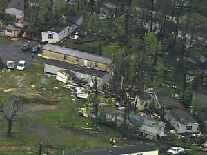 Sky 5 flies over destroyed mobile homes in the Stony Brook mobile home park near Brentwood Road in Raleigh.