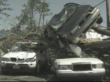 Cars were tossed and stacked by tornadic winds on Fayetteville's Reilly Road