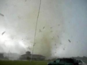 A video filmed by a Wilson man who sat calmly in his truck as whipping winds and flying debris engulfed the area during a tornado touchdown Saturday has gone viral, prompting interview requests from as far away as Japan.