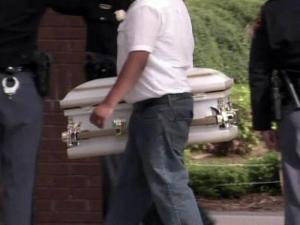 The casket of one of the four children killed in north Raleigh mobile home during an April 16, 2011, tonado is carried into St. Raphael Catholic Church, where the children's funerals were held on April 20, 2011.