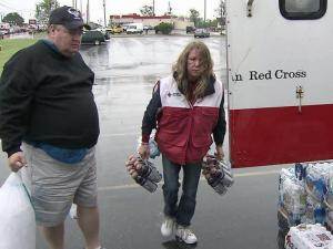 Red Cross volunteers fanned out across central North Carolina this week to offer aid and comfort to those who lost homes and belongings in the storms.