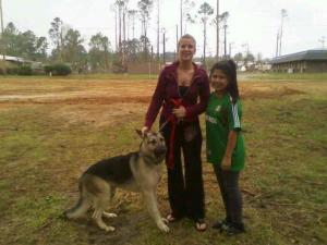Meagan Alfonzo and her niece, Teresa Esparoza, shortly after being reunited with Raider, a 1-year-old German Shepherd that was sucked up into a funnel cloud on April 16.