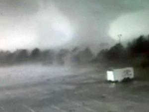 A Kenly couple laid in a ditch April 16 to escape the ferocious twister that blasted through their mobile home and severely crippled operations at a nearby high school.