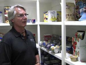 Rex Bost of Bost Custom Homes shows a safe room designed to double as a pantry.