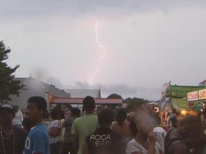 Lightning at the North Carolina State Fairgrounds, where Raleigh city officials canceled a fireworks celebration Monday night. The event has been rescheduled for 9 p.m. Tuesday.