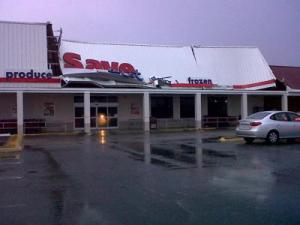 The sign at the Save-A-Lot grocery store in Roanoke Rapids was damaged by strong winds that moved through the city on July 4, 2011.