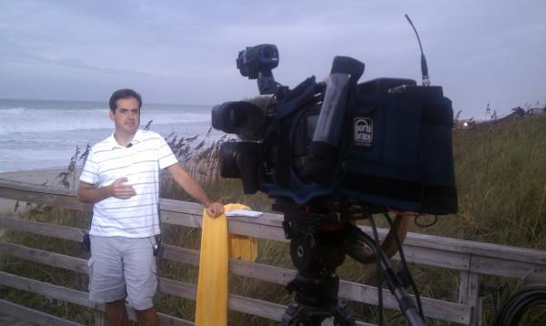 Bryan Mims on Atlantic Beach pier, Aug. 26, 2011, waiting for Hurricane Irene