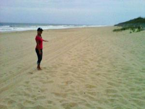 Reporter Renee Chou enjoys some quiet time on the beach at Kill Devil Hills.