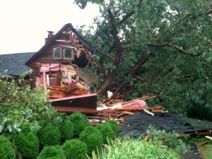 A severe thunderstorm pummeled Chatham County Monday evening, sending a large tree crashing through this house on Johnny Burke Road.