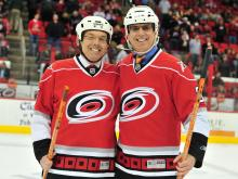 Greg Fishel and Mike Maze compete in the media shootout during the first intermission of the Carolina Hurricanes vs. Washington Capitals NHL hockey game in Raleigh, N.C. Monday, February 20, 2012. Maze beat Fishel 9 to 8.
