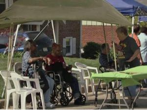 Residents of Raleigh's King Charles Road celebrated Saturday, a year after tornadoes left their street damaged.
