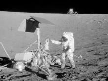 Apollo 12 Commander Pete Conrad retrieves samples from the Survey 3 for study. (Source: NASA)