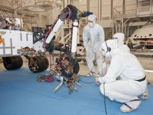 Bunny-suited engineers work in a clean room with Curiosity the rover scheduled to arrive at Mars in August. (Source: NASA/JPL)
