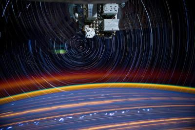 Long-exposure photographs reveal trails created by stars rotating around Polaris (Credit: Petit/NASA)