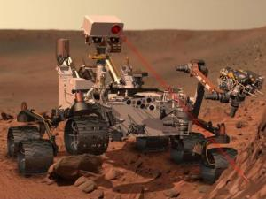 Artists rendition of Curiosity as it fires its laser to analyze a rock sample (Credit: NASA/JPL)