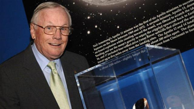 Neil Armstrong stands next to the Ambassador of Exploration Award at the Cincinnati Museum Center at Union Terminal. (Credit: NASA/Bill Ingalls)