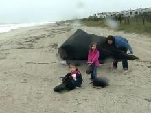 Family won't let Sandy spoil beach fun