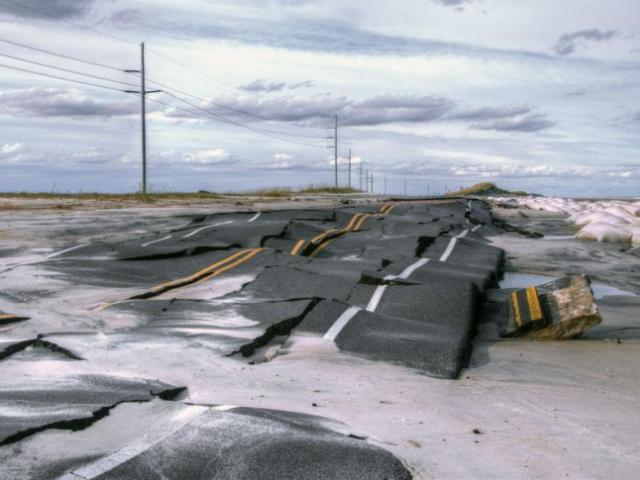 Damage to N.C. Highway 12 between Pea Island and Rodanthe, as seen on Oct. 30, 2012.<br/>Photographer: Donny Bowers