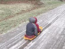 Icy streets draw brave to sleds
