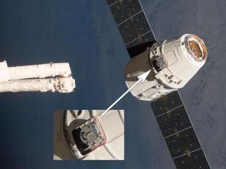 Flight-Releasable Grapple Fixture is visible as the SpaceX Dragon capsule approaches the ISS