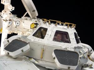NASA astronaut George Zamka is pictured in a window of the Cupola of the International Space Station shortly after protective shutters were removed. (Image credit: NASA)