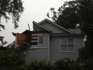 A tree crashed into a house in the 1400 block of Wake Forest Road during severe thunderstorms on June 13, 2013.