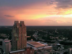 A view of the sunset from atop PNC Plaza in downtown Raleigh after storms swept the region on June 13, 2013. Photo by Chad Flowers
