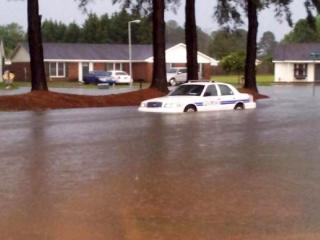 A police cruiser is stuck in water on Evanston Road in Fayetteville after thunderstorms caused flash flooding in the area. (Photo submitted by Billy Marts)