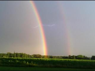 Hillary Manship took this photo of lightning and a double rainbow Wednesday, Aug. 21, 2013.