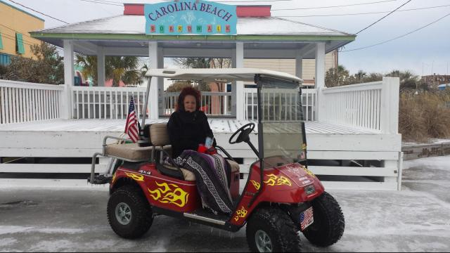 Carolina Beach winter wonderland. Golf cart riding on the beach in the ice and snow