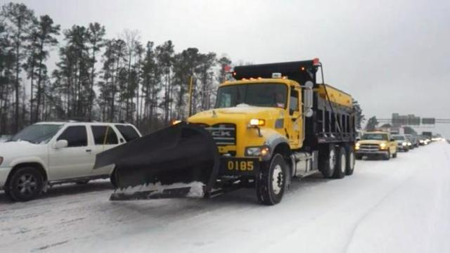 A truck with the North Carolina Department of Transportation clears snow on U.S. Highway 1 in Cary on Feb. 12, 2014.