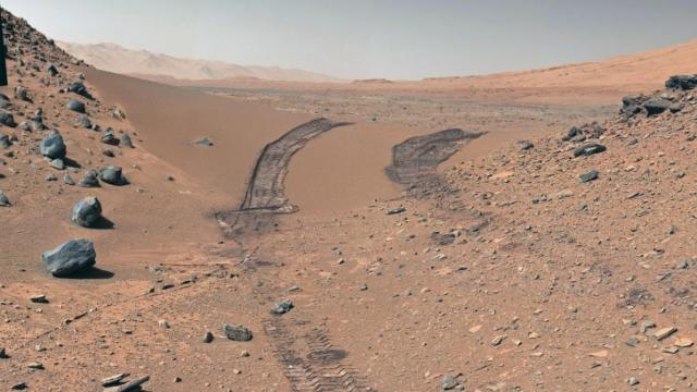 Tracks left by the one-ton Curiosity rover after climbing a sand dune on Mars. The wheels are about 9 feet apart. (Photo: NASA/JPL-Caltech/MSSS)
