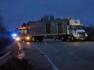 Authorities closed the ramp from I-40 to Person Street Tuesday, March 18, 2014 due to a wreck involving a tractor-trailer and a CAT bus.