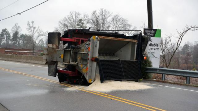 A salt truck overturned on Fox Road at Interstate 540 Tuesday morning due to slick conditions.