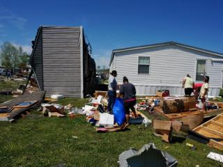 A mobile home ended up on its side on Friday, April 26, 2014 after storms ripped through Elizabeth City, N.C.