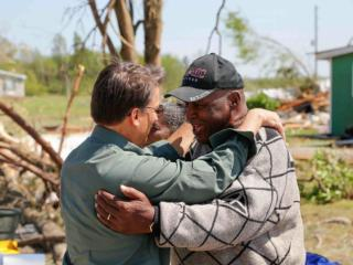 Gov. Pat McCrory meets with Winfall Mayor Fred Yates on Sunday, April 27, 2014, during an eastern North Carolina tour of damage from at least eight tornadoes two days earlier. (Courtesy McCrory Press Office)