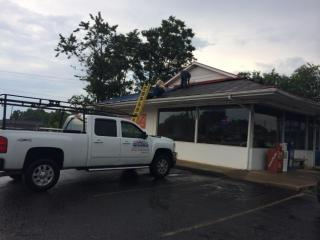 Wind damaged the roof Wednesday at the Brass Kettle restaurant in Sanford.