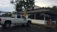 IMAGES: Strong winds result in near miss for Sanford couple