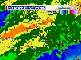Estimate of standard 24-hr rainfall from the NWS NEXRAD radar, ending 8:05 AM Wednesday, July 16 2014. Light blue shading indicates a tenth of an inch, with light green one inch, yellow two inches and orange three inches or more.