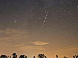 A Perseid meteor visible low on the light-polluted horizon. (Photo by Ken Christison)