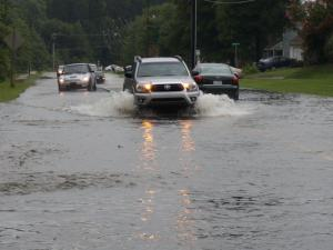 Heavy rain Friday afternoon flooded street and sidewalk in Durham near East Carver Street and Meriwether Drive.