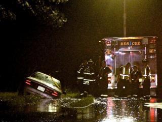Emergency personell rescue a stranded drvier in Smithfield. Photo by John Payne